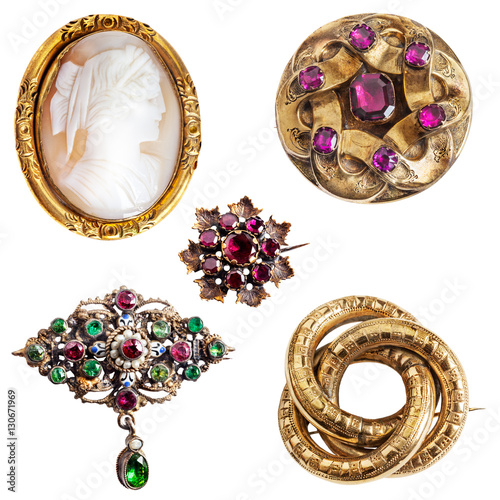 Antique and well worn gold jewelry - cameo,  amethyst, enamel, garnet and three- Fototapeta