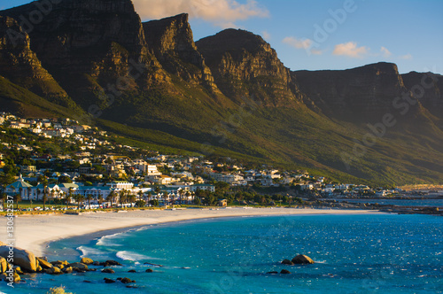 Poster Afrique du Sud Camps Bay beach with the view of the Twelve Apostles mountain range. Cape Town. South Africa