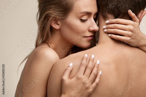 Fotografie, Obraz  Beautiful Young Woman Smelling Man Smooth Skin. Couple In Love