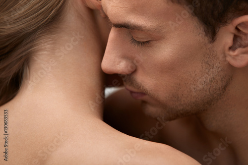 Fototapeta Skin Smell. Closeup Of Male Smelling Female Skin. Body Cosmetics obraz