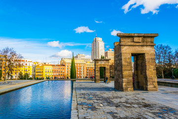 egyptian temple of debod surrounded by business district in madrid