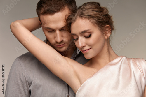 Photo Man Close To Sexy Woman. Female Showing Smooth Skin Of Armpits.