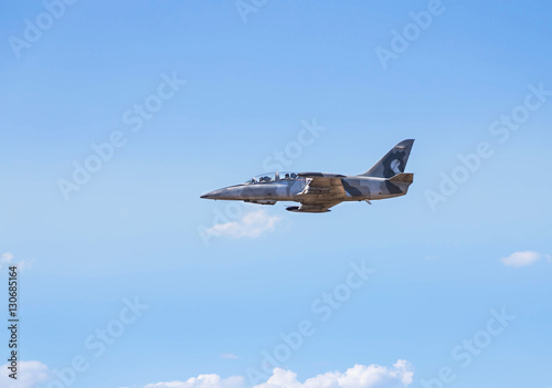 Fotografie, Obraz  L-39 albatros fighter jet flying on sunset  background on white blue sky  backgr