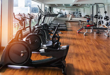 Rows Of Stationary Bike And Health Exercise Equipment For Bodybuilding In Gym Modern Fitness Center Room