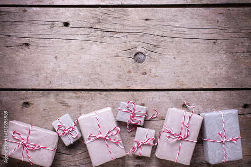 Poster Fleur Border from wrapped christmas presents on aged wooden backgroun