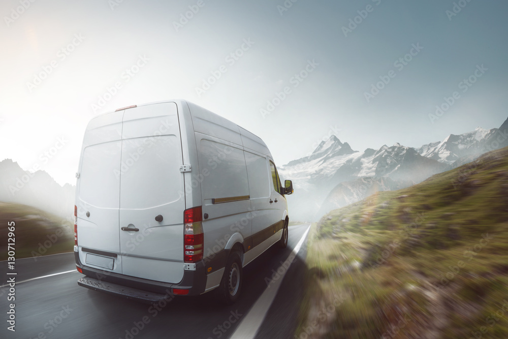 Fototapety, obrazy: Delivery truck drives on a mountain road