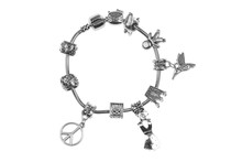Small Silver Charm Bracelet With Many Charms Isolated On White Background