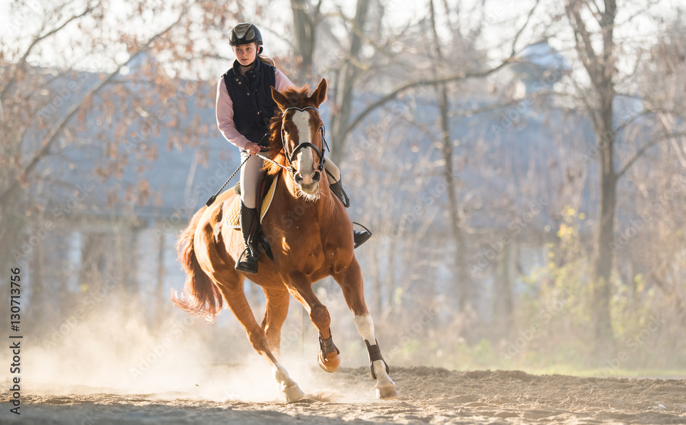 Fototapety, obrazy: Young girl riding a horse