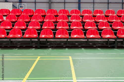 Foto op Plexiglas Stadion red rows of seats in a sports hall