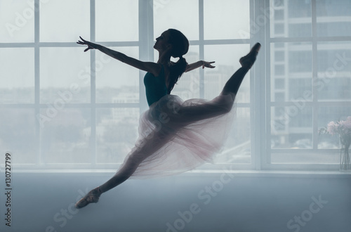 Fotografie, Tablou  Ballerina in the jump in front of a window