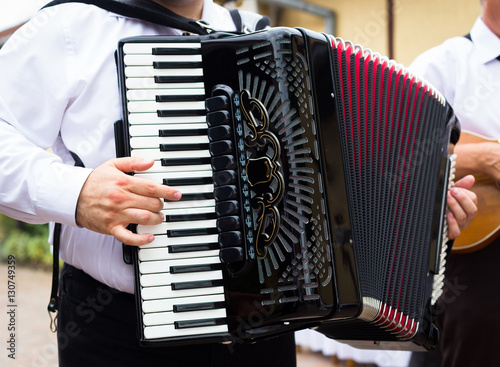 Hand playing accordion closeup Slika na platnu
