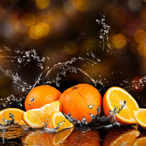Poster Fruits Orange fruits and Splashing water