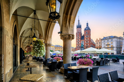 In de dag Krakau St Mary's Basilica and Main Market Square in Krakow, Poland, on sunrise