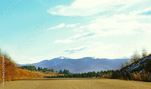 Fotobehang Lichtblauw Beautiful landscape with asphalt road in mountains
