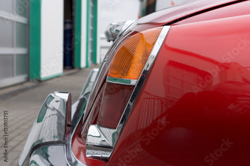 Closeup of red old retro car backlight © kelifamily