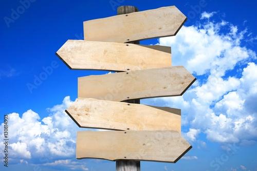 Fotografía  Wooden signpost with 5 arrows