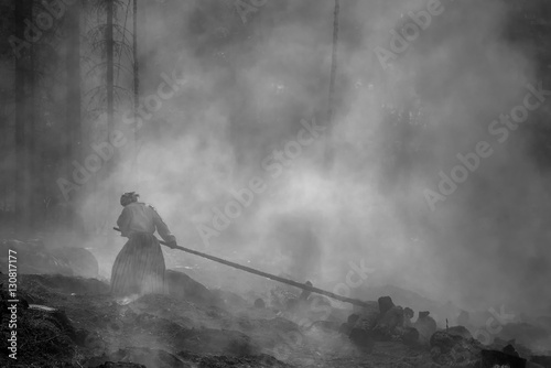 Fotografie, Obraz  Traditional slashing and burning in Koli National Park with people being protect