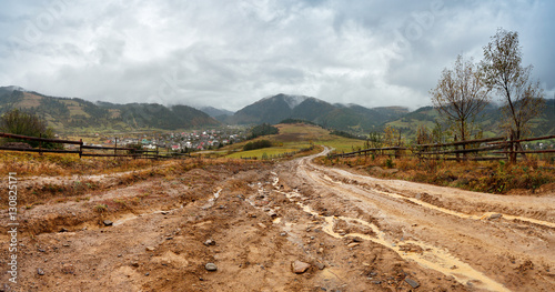 Muddy ground after rain in mountains. Extreme path rural dirt ro Canvas Print