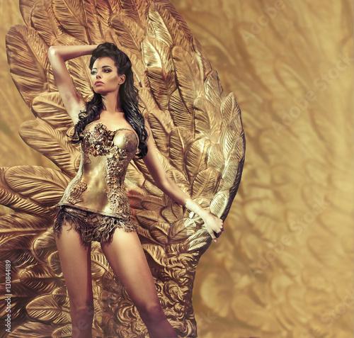 Poster Artist KB Alluring brunette holding a huge golden wing