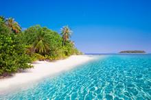 Tropical Island With Sandy Bea...