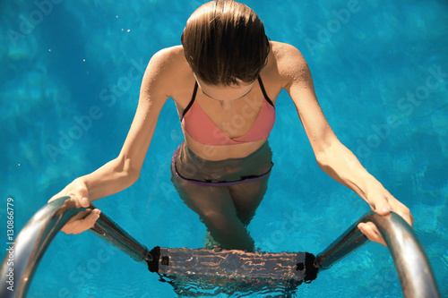 f6bcb5e275c Beautiful young woman stepping out of swimming pool - Buy this stock ...