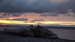 Timelapse Seattle Golden Gardens Beach Brightly Colored Sunset Birds Fly By Driftwood on Beach