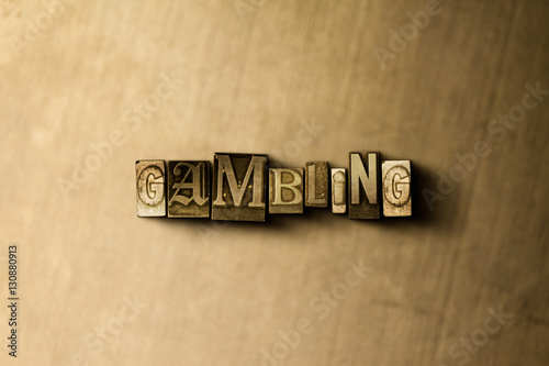 GAMBLING - close-up of grungy vintage typeset word on metal backdrop плакат