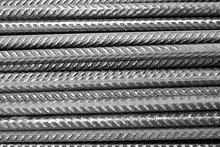 Closeup Of A Stack Of Rusty Metal Deformed Reinforcement Bars / Steel Rods From A Construction Site  (black And White Version)