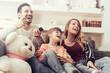 Leinwandbild Motiv Happy family watching TV together at home