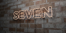 SEVEN - Glowing Neon Sign On Stonework Wall - 3D Rendered Royalty Free Stock Illustration.  Can Be Used For Online Banner Ads And Direct Mailers..
