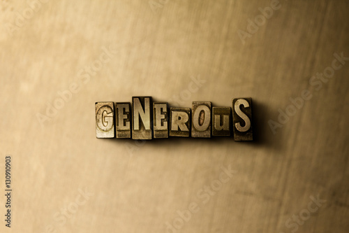 Photo  GENEROUS - close-up of grungy vintage typeset word on metal backdrop