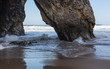 Adraga Beach (Praia da Adraga) in Portugal. Beautiful place, golden sand. Rough sea, rocks, whitewash, blue sky.