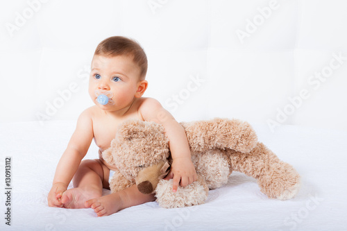 Fotografie, Obraz  Baby with blue eyes smiling on white background