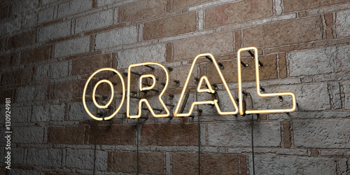 Fotografie, Obraz  ORAL - Glowing Neon Sign on stonework wall - 3D rendered royalty free stock illustration