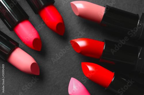 Fotografiet  Many lipsticks on dark background