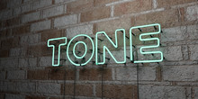 TONE - Glowing Neon Sign On St...