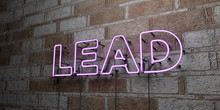 LEAD - Glowing Neon Sign On Stonework Wall - 3D Rendered Royalty Free Stock Illustration.  Can Be Used For Online Banner Ads And Direct Mailers..