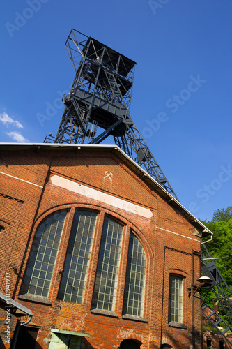 Staande foto Industrial geb. Black coal mine, Landek, Ostrava, Czech Republic / Czechia, Central Europe - tower with wheel and elevator. Detail of historical industrial architecture.Building is made of red brick masonry