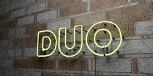 DUO - Glowing Neon Sign On Stonework Wall - 3D Rendered Royalty Free Stock Illustration.  Can Be Used For Online Banner Ads And Direct Mailers..