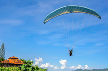 Back Of The Paragliding Man In...