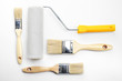 Leinwanddruck Bild - Painting roller and brushes on white textured background