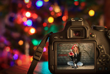 Christmas Scene Of A Digital Camera In Front Of A Christmas Tree.
