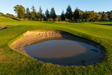 Sand Trap Nearly Full Of Water Near Green