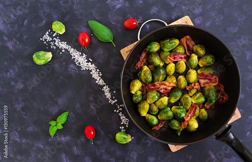 Photo Stands Brussels Roasted brussels sprouts with bacon on dark background. Top view