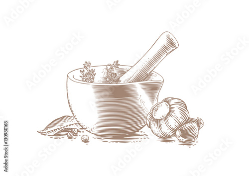 Photo Mortar bowl and pestle with spice, herb and garlic
