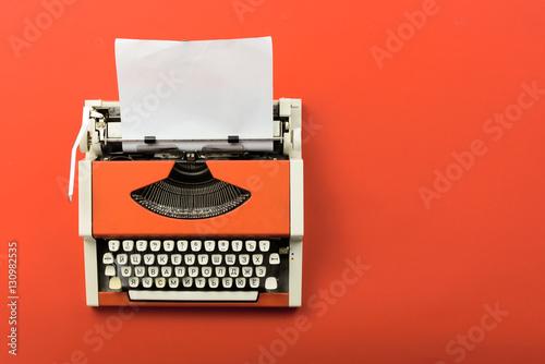 Fotografie, Obraz  Red vintage typewriter with white blank paper sheet