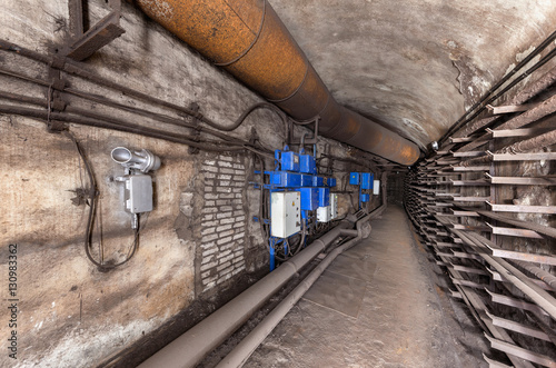 Fotografija Electrical cabinets and other equipment in underground communication tunnel