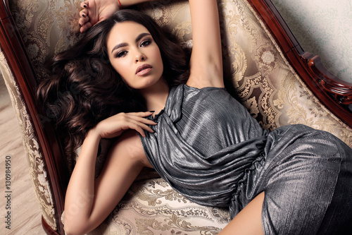 gorgeous woman with dark hair in elegant clothes