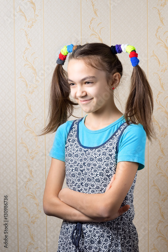 portrait of a smiling 11 year old girl with funny tails in the style of Pippi Longstocking standing with arms crossed Fototapet
