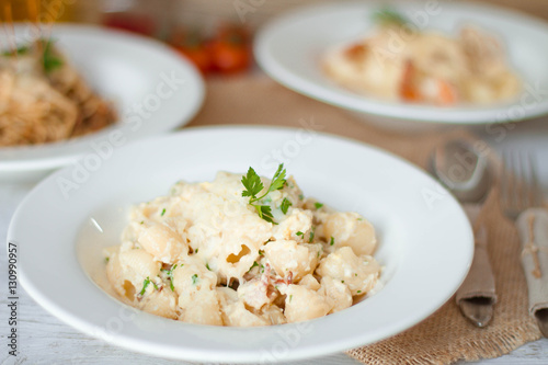 Poster Dairy products Spaghetti with tomato paste, hot Chili peppers and olive oil. On rustic background. Top view
